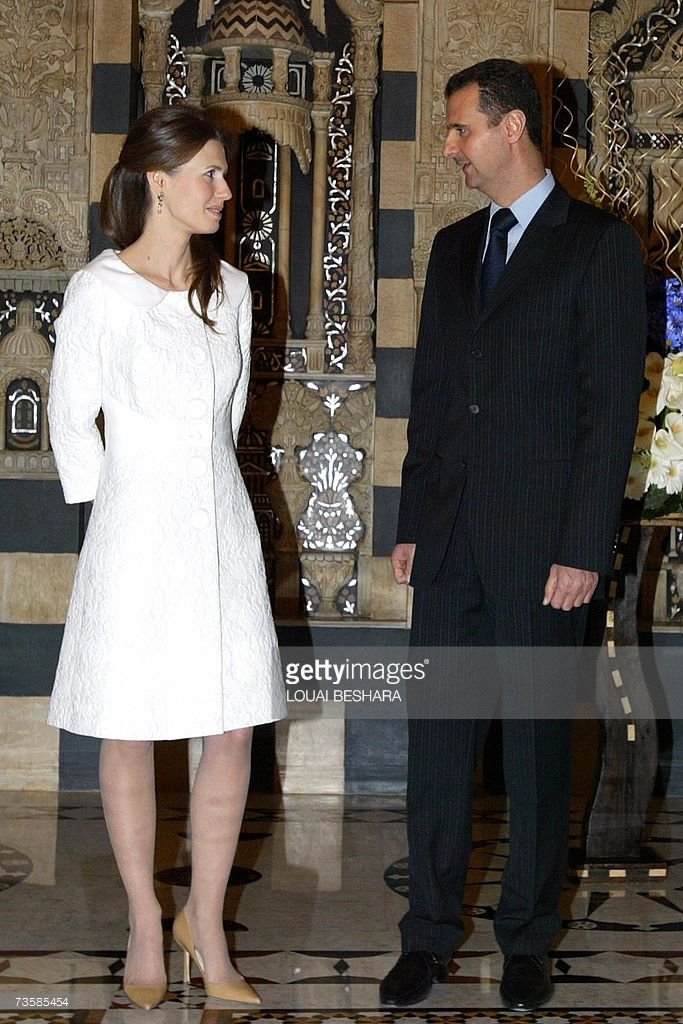 Syrian President Bashar al-Assad speaks with his wife Asma during a reception for Teacher's day in Damascus, 15 March 2007.