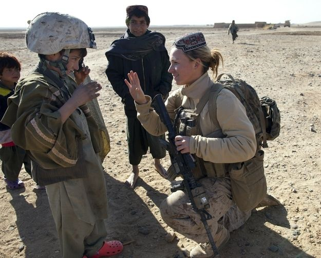 Doing outreach in the field. This is a marine talking to a little boy:)