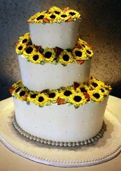 wedding cake green and black with sunflowers | oval shaped wedding cake, decorated with buttercream sunflower ...