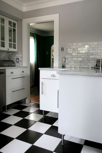 A dream...black and white checked kitchen flooring, yes please!