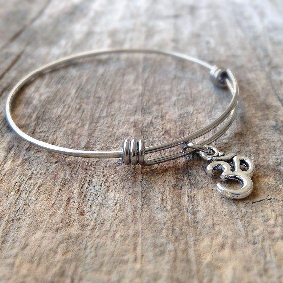Hey, I found this really awesome Etsy listing at https://www.etsy.com/listing/210779939/yoga-bracelet-om-bangle-bracelet-om