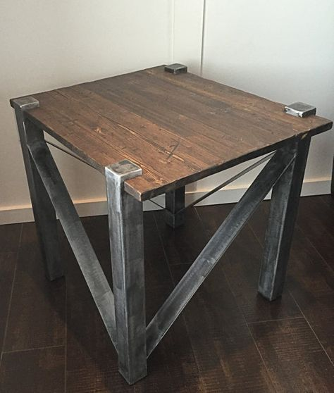 Rustic modern industrial end table. Metal base with distressed pine top.  Dimensions: height-22 1/4  Width-20  Depth-24 Other colours/finishes available upon request as well as custom sizes.
