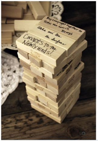 Wedding sign in with Jenga blocks! How good is this! Not sure cost of flying it home though!