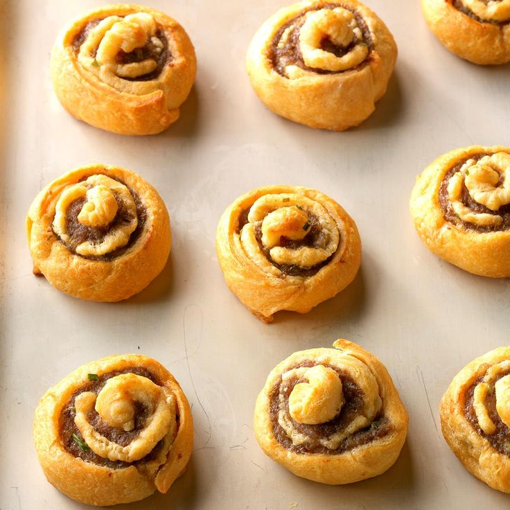 Sausage Chive Pinwheels Recipe -These spirals are simple to make but look special on a buffet. Our guests eagerly help themselves, and sometimes the eye-catching pinwheels never even make it to their plates! —Gail Sykora, Menomonee Falls, Wisconsin