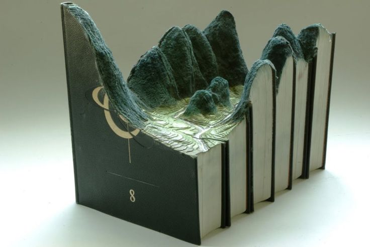 Book landscapes by Guy Laramee, repurposed book art, recycled book art, book sculptures, landscapes in books, book world art, Guy Laramée art, Guy Laramée,