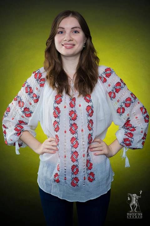 Tatiana is wearing the traditional blouse with a bright smile! And she looks amazing! Photo: Uncle Jeb Studio