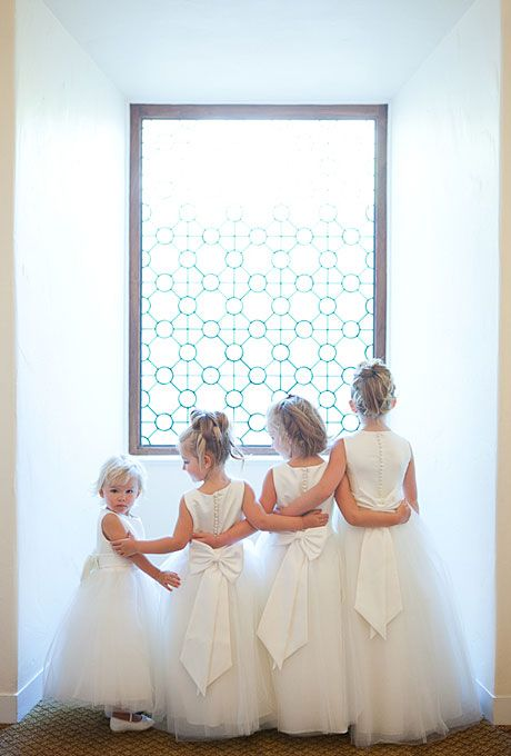 David's Bridal white, tulle flower girl dresses with satin bows (Melissa Musgrove Photography)
