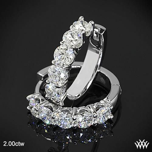 """Eternally brilliant, these """"Shared-Prong"""" Diamond Hoop Earrings are the ultimate in style and class. With 4 dazzling carat weights to choose from, you can pick the pair that suits you best. Each is set with 10 gorgeous <a href='http://www.whiteflash.com/about-diamonds/diamond-education/a-cut-above-hearts-and-arrows-diamond-melee-938.htm'><u><b>A CUT ABOVE® Hearts and Arrows Diamond Melee</b></u></a> and 2 surprise <a…"""