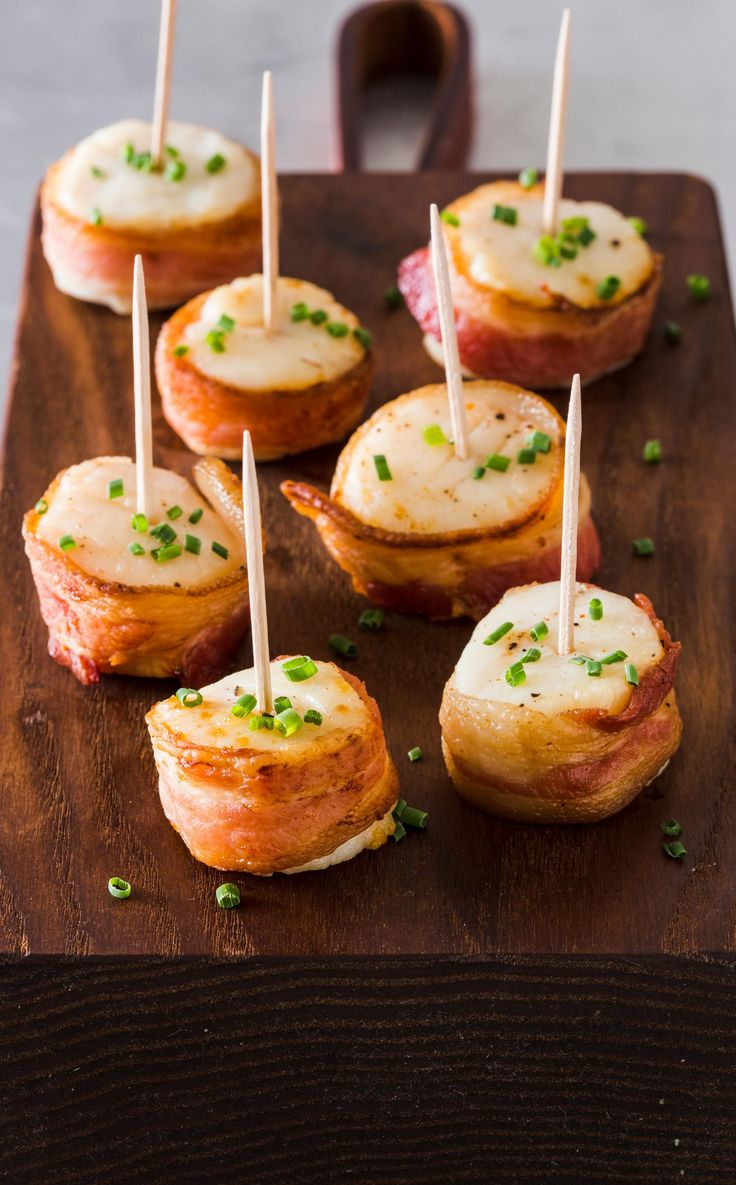 Broiled Bacon-Wrapped Scallops. A staple of cocktail parties for generations, bacon-wrapped shrimp combines smoky pork and briny shrimp to great effect.