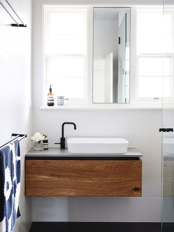 Floating vanity, stacked towel bars, and a mirror in front of a window - all great ideas for a tiny bath