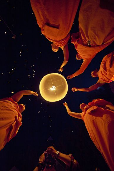 """Festival of Lights  Photograph by Fredrik Lonnqvist, My Shot    Monks release a floating lantern during the Loy Krathong festival in Chiang Mai, Thailand. A """"fellow"""" photographer is trying to hog my shot. Luckily for me, he added so much more"""