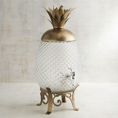 Boost the elegant tropical vibe of any gathering with our Pineapple Beverage Dispenser. Shaped like your favorite prickly fruit, it adds extra hospitality to parties. Buffet centerpiece or drink station accent—it's a beautiful way to fill your glass with punch, iced tea or pineapple juice.