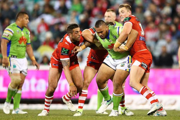 Junior Paulo of the Raiders is tackled during the round 19 NRL match between the Canberra Raiders and the St George Illawarra Dragons at GIO Stadium on July 14, 2017 in Canberra, Australia.