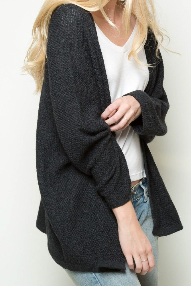 Caroline Cardigan by Brandy Melville. The back of the cardigan also has a soft v-opening. Love!