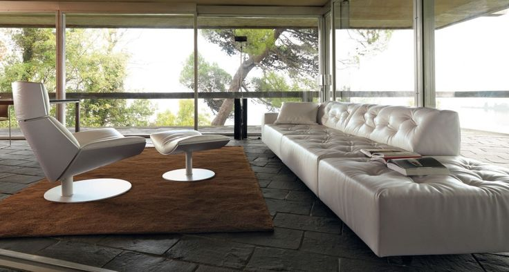 White leather couch covers with matching rug