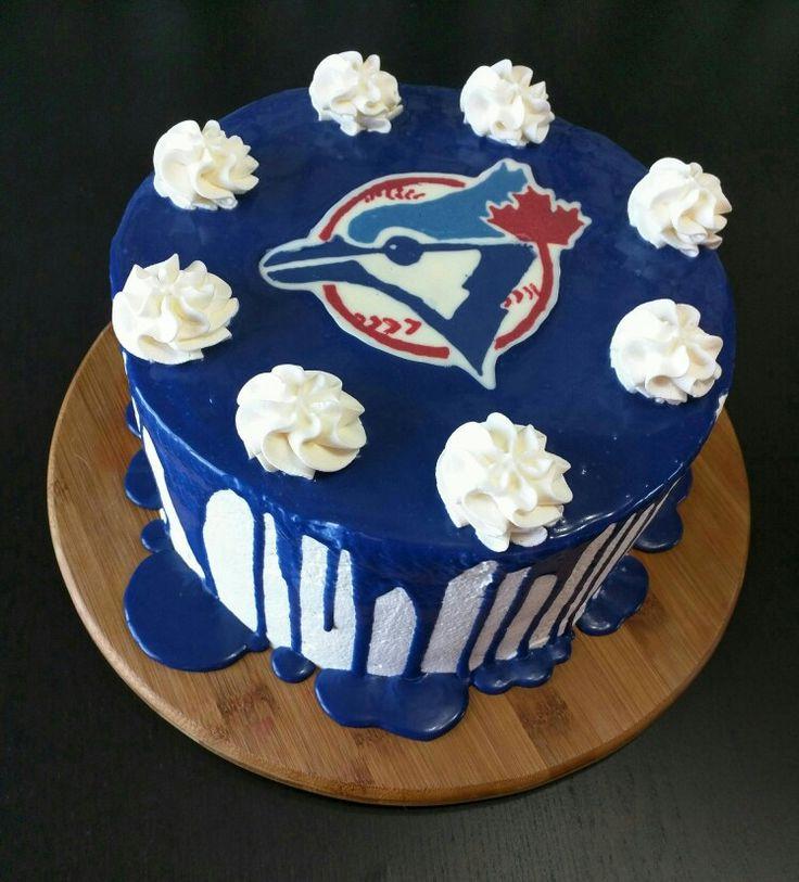 Toronto blue jays cake. Canadian baseball cake. Homemade cake made with whip cream and chocolate garnishes. White and blue cake.
