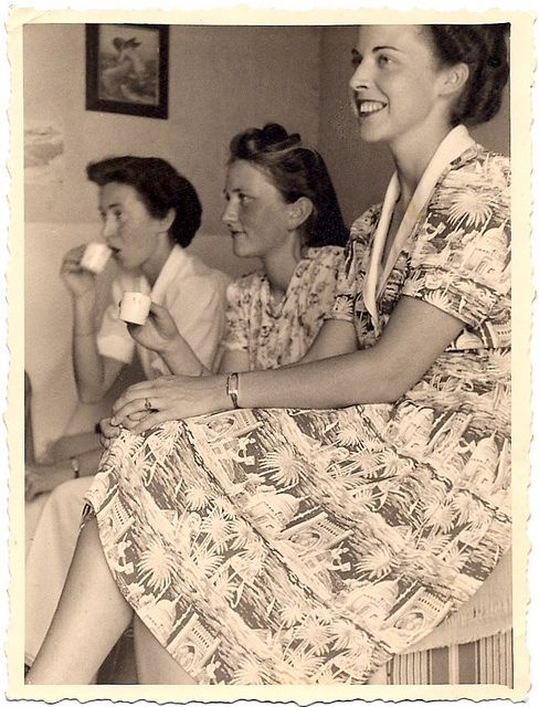 Charming to no end! (Don't you just love the great print on the dress the woman closest to the lens is wearing?)