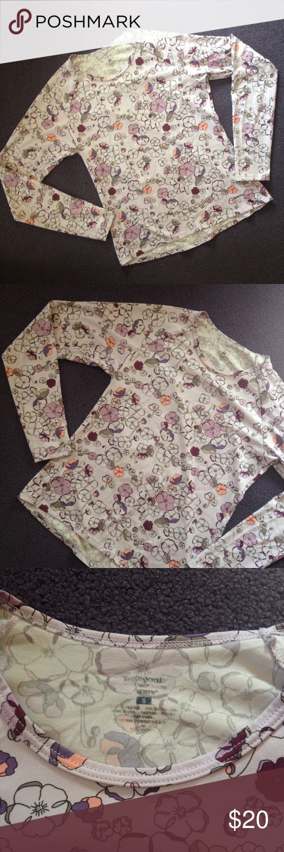 Patagonia capilene long sleeve top floral print S Patagonia Capilene top in a sweet floral print. Reminds me of cherry blossoms. The shirt is primarily shades of purple with gray and peach accents. In great shape - only significant sign of wear is that the inside printed tag area is starting to wet away a bit (see pics). Size small. Unstretched measurements available in photos. Questions, offers, and bundles welcome!! Patagonia Tops Tees - Long Sleeve