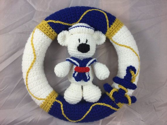 ***** This is a listing for the pattern only - not the finished item *****  This is a pattern for a very sweet Nautical Wreath, with a really cute bear dressed as a sailor, with his cute little hat and scarf:). The pattern could easily be made for a little boy or girl, just by switching out the blue for pink. This would make the cutest decoration on your front door or in a Nautical Themed Nursery. I hope you are ready to make a few of these, because once your friends see this cutie they are…