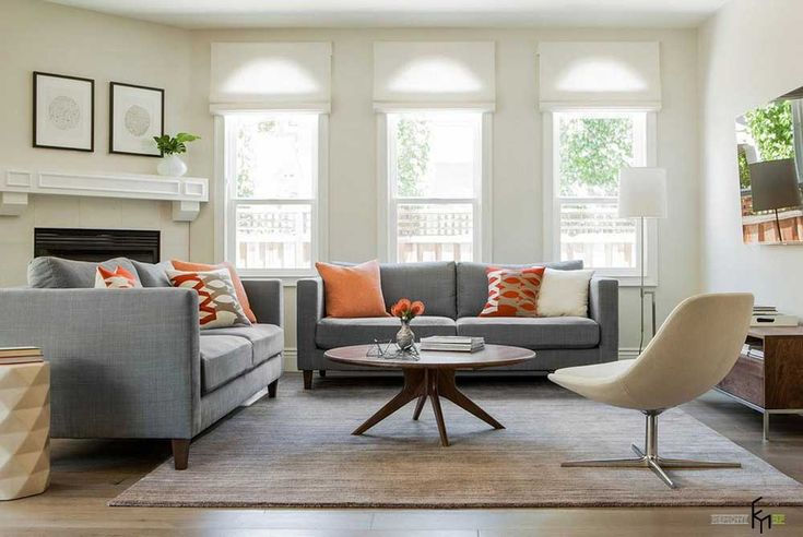 Grey Sofa Living Room Design Ideas with amusing round wooden table and astounding orange patterned cushions also sweet elegant cream chair