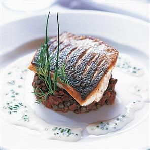 Fillets of sea bass on provencal lentils recipe. Give your guests a bit of oo la la with this sophisticated dish of fillets of sea bass on provencal lentils.