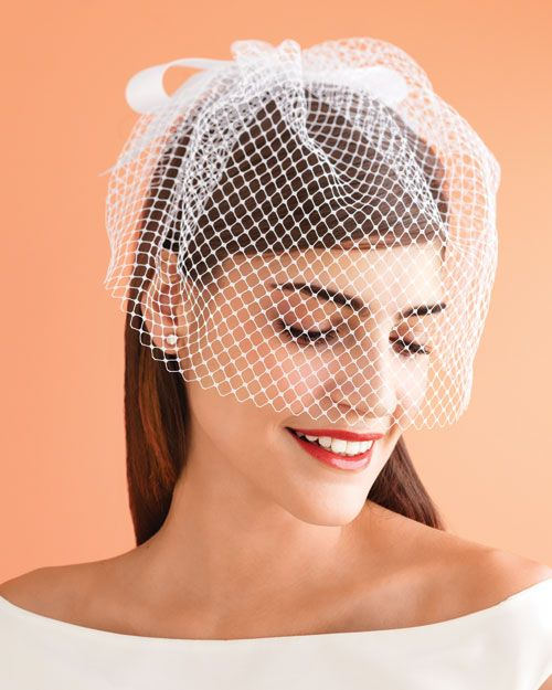 To create the veil template, cut a piece of kraft paper to 24 by 12 inches. Measure up 5 inches on each end, and cut the corners at a roughly 45-degree angle (the longest side becomes the bottom of the veil).