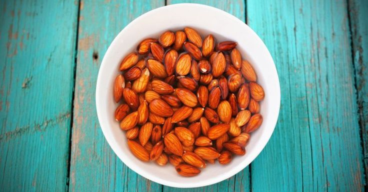 You should soak almonds before eating them to get more nutrients and absorb them better. Soak 1 cup almonds in 2 cups water overnight or for 18 hours (Ayurvedic practitioners believe that eating soaked almonds first thing in the morning can help regulate your stomach acidity. This aids protein digestion through the day, protecting you from heartburn and other gastric symptoms)