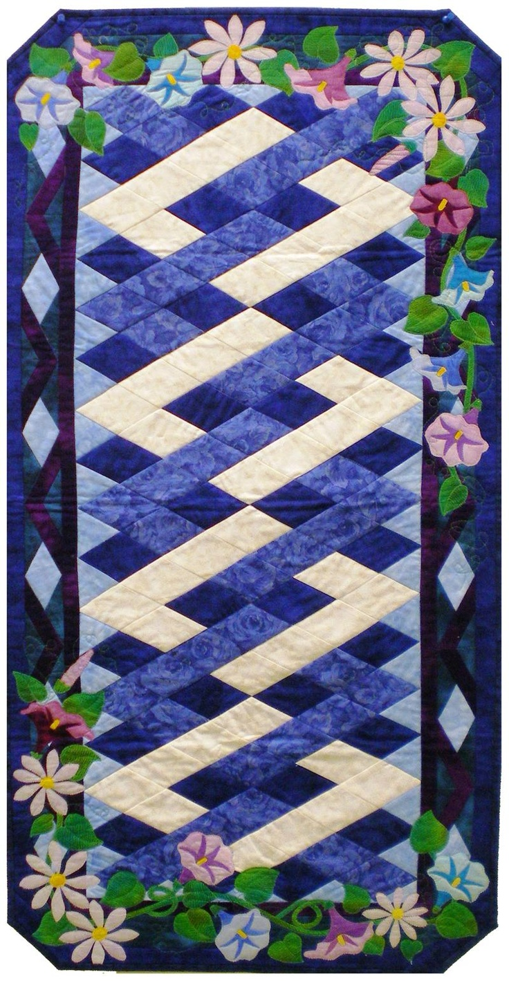 I absolutely love this tablerunner.  I can see it in so many color ways.  I'm getting this pattern ASAP. September Morning Glories & Asters Table Runner
