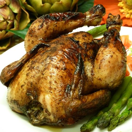This Cornish hen recipe uses an easy sweet and spicy glaze flavored with balsamic vinegar, honey, red wine, allspice, sage, and chili powder. Chicken may be substituted.