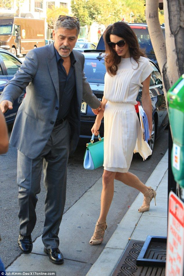 Chivalrous: George, who lead the way as he left with Amal, said he has no plans to enter p...