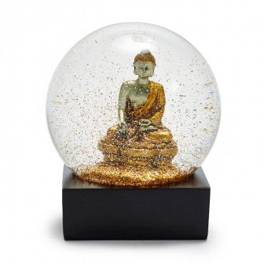 Golden Buddha Snow Globe  Illuminated in coordinating confetti, this golden Buddha represents enlightenment and peace, two fitting moral pillars for the holiday season. Each globe melds sophistication with whimsical delight.