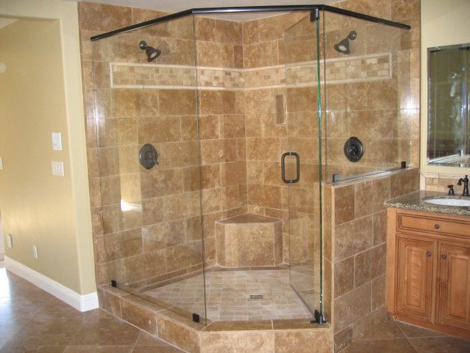 beautiful double head shower on brown marble walk in shower wall also single swing glass shower