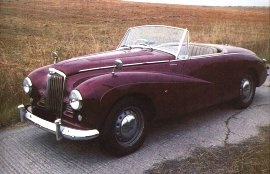 1953 Sunbeam Alpine Series I - This was one of my dad's first cars. He talked about it and I have a pic of him & Mom leaning against it when they were very young.