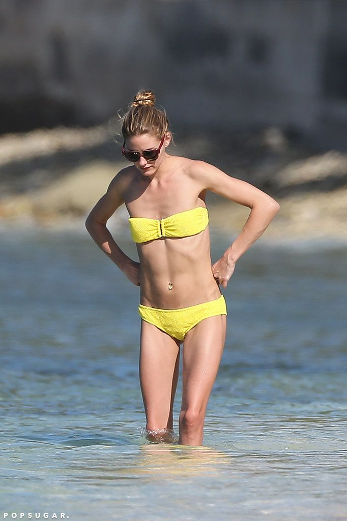 Olivia Palermo flaunted her figure in a sunny bandeau bikini while vacationing with her hubby in St. Barts.