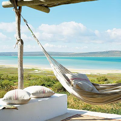 rustic beach patio with hammock