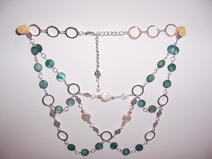 Green MOP flat rounds, freshwater pearl buttons, silver spirals and silver rings create this elegant necklace. $65