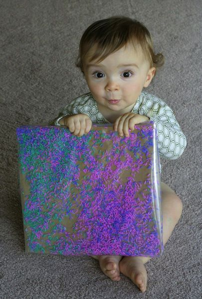 Combine sensory play with art and crafts time using colored grains of rice, some contact paper and a plastic bag for shakes! Even if baby is more interested in dumping and sifting, the vivid colors will get creative juices flowing. #DIY