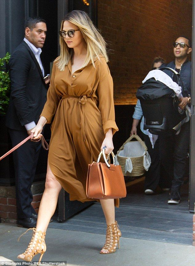 All on board: Chrissy Teigen and husband John Legend jetted out of New York on Friday with...
