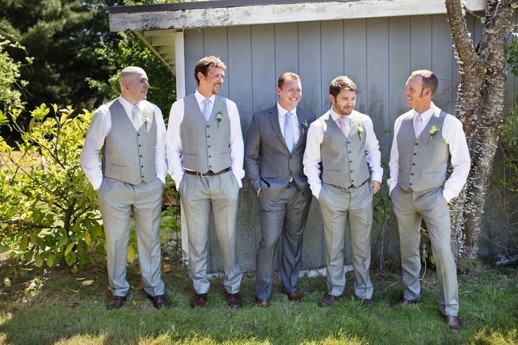 Gray suits. Groom wore a darker gray suit and groomsmen wore light gray pants and vests #OliverManuelPhotography #mismatchedgroomsmen