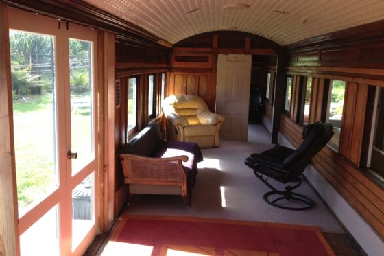 Living space, doors opening to the deck