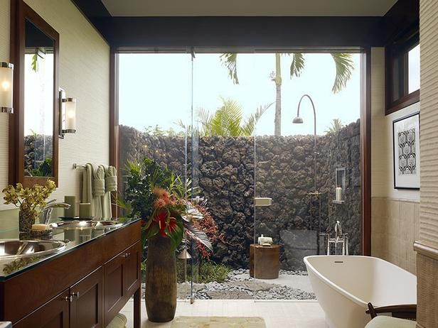 the perfect bathroom - bathe outdoors surrounded by a natural stone wall, then step just three feet into a private bathroom outfitted with a freestanding tub and double vanity