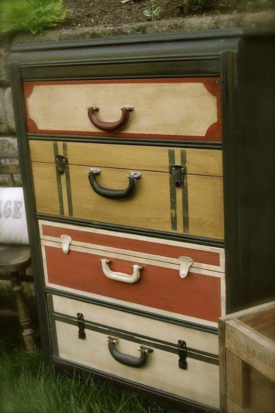 Cada cajón de esta vieja cómoda esta pintado como si fuese una maleta.Made by Barn Door Decor.