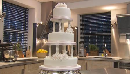 Traditional wedding cake.  The neat thing about this traditional wedding cake in the UK is that you can make it a month ahead of time, and it is firm enough to support some nice fondant icing.  It is like our fruit cake, except it has white icing.
