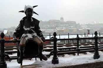 The Little Princess statue on the Danube Promenade (Duna Korzó) in winter.