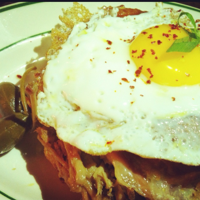 """Decadent """"croque señora"""" (open faced Cuban w gooey melted Gruyere and fried egg on brioche) at Nights  Weekends."""