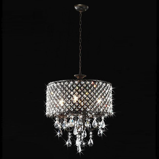 Brighten up your home in a dramatic and beautiful way with this round crystal chandelier from otis designs this lighting fixture features am antique bronze