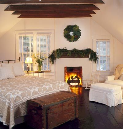 Nestle In! Don't overlook the opportunity to create an unconventional mantel display in the bedroom. A simple wreath and garland made of greenery can take the space into cozy holiday mode in no time.