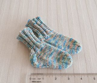 These ribbed socks for baby are stretchy enough to stay up all day when knit in Patons Stretch Socks. (Patons Yarns)