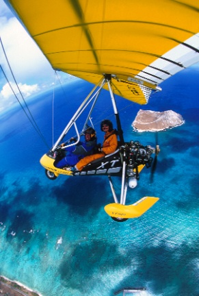 Scary but fun!! Paradise Air Powered Hang Gliding Oahu Hawaii North Shore Ultralight Microlight Instruction ecotour Trike Glider Airplane