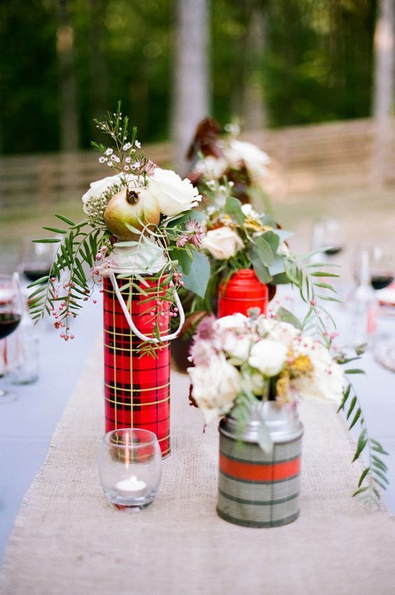 flowers in plaid thermoses as centerpieces / http://www.deerpearlflowers.com/camp-wedding-ideas/2/